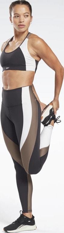 Reebok Lux High Rise Leggings worn stretching