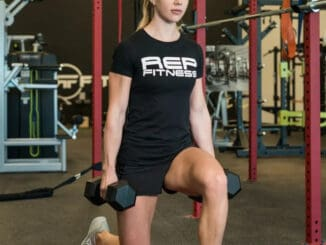 Rep Fitness Block Logo Womens Tee with a model